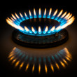 Gas flame forming crown in the dark - Stock Photo