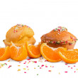 Muffins with orange isolated on white — Stock Photo