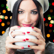 Brunette girl with a cup of coffee — Stock Photo