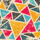 Grunge colored triangle seamless pattern — Stock Vector