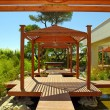 Stock Photo: Wood pavilion, deck and tropical plants in summer resort