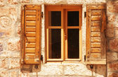 Old window with wooden shutter — Stock Photo