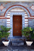 Door entrance in ornate stone house(Greece) — Stok fotoğraf