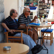 Two senior men sitting in outdoor cafe(Greece) — Foto de Stock