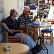 Two senior men sitting in outdoor cafe(Greece) — Stockfoto