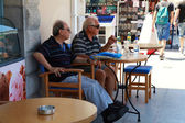 Two senior men sitting in outdoor cafe(Greece) — Stock Photo