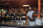 African cook in tribal restaurant (South Africa) — Stock Photo