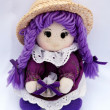 Doll in violet — Stock Photo