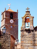 Bell towers with clock, cross and weathercock — Stock Photo