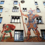 Постер, плакат: David and Goliath fresco on medieval house wall Regensburg Germ