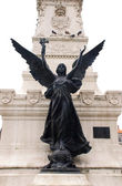 Statue of angel with cross(Portugal) — Stock Photo