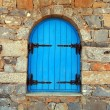 Vintage window with blue close shutters, Crete, Greece. — Stock Photo