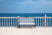 White bench, balustrade and empty terrace overlooking the sea — Stock Photo