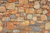 Rough mediterranean stone wall as background. — Stock Photo