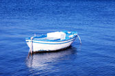 Blue and white old wood boat at a Mediterranean sea(Greece) — Stock Photo