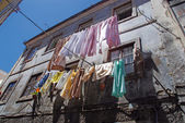The linen is dried in old portugal town — Foto de Stock