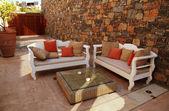 Beautiful mediterranean patio with white outdoor furniture(Greec — Stock Photo