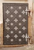 Ornate antique metal door — Stock Photo
