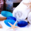 Royalty-Free Stock Photo: Towels , starfishes and blue stones