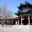 Red chinese pavilion with blue ornate roof — Stock Photo #14130555