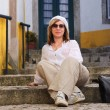 Woman in mediterranean town(Portugal) - Stock Photo