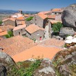 Mountain village with red roofs — Stock Photo #14674905