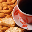Coffee with biscotti on almond background - Stock Photo