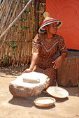 Sotho woman cooking maize meal — Stock Photo