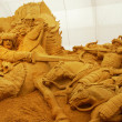 Sand sculpture of knightly battle - Stock Photo