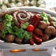 Gourmet roasted sausages with tomatos cherry - Stock Photo