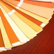 Open pantone sample colors catalogue on wood background - Stock Photo
