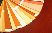 Open pantone sample colors catalogue on wood background — Stock Photo