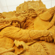 Stock Photo: Sand sculpture of knightly battle