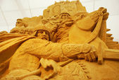 Sand sculpture of knightly battle — Stock Photo