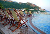 Swimming pool, terrace and outdoor chairs (Montenegro) — Stock Photo