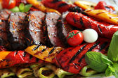 Grilling meat with vegetables — Stock Photo