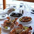 Dinner with grilled lobsters in mediterranean tavern(Greece) — Zdjęcie stockowe