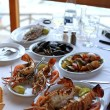 Dinner with grilled lobsters in mediterranean tavern(Greece) — Foto Stock