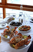 Dinner with grilled lobsters in mediterranean tavern(Greece) — Stock Photo