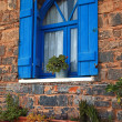 Постер, плакат: Vintage blue window with shutter Greece