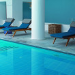 Blue resort pool interior with pool bed — Stock Photo