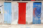 Multicolored mediterranean run-down doors — Stock Photo