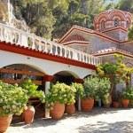 Постер, плакат: Beautiful old garden of monastery Crete Greece