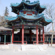 Traditional chinese pavilion with green ornate roof — Stock Photo #21255545