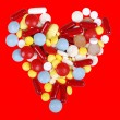 Stock Photo: Red heart of pills