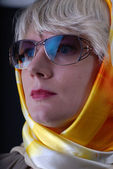 Woman wearing sun glasses and neckerchief — Stock Photo