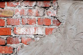 Old brick wall with concrete — Stock Photo