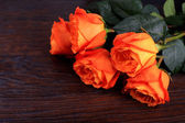 Roses on wood background — Stock Photo