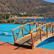 Swimming pool, foot bridge and beach in resort(Greece) — Stock Photo