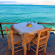 Greek outdoor restaurant with Mediterranean sea view(Crete, Gree — Stock Photo #24144529